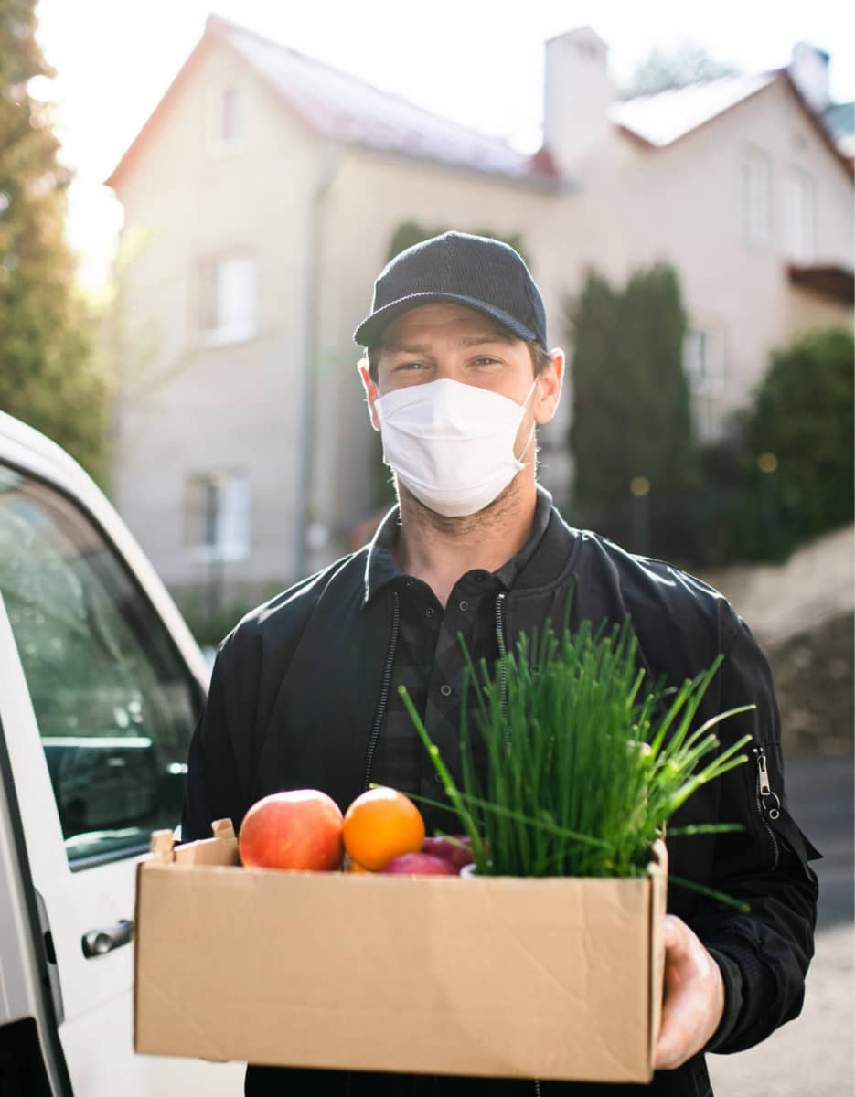 delivery-man-courier-with-face-mask-delivering-groceries