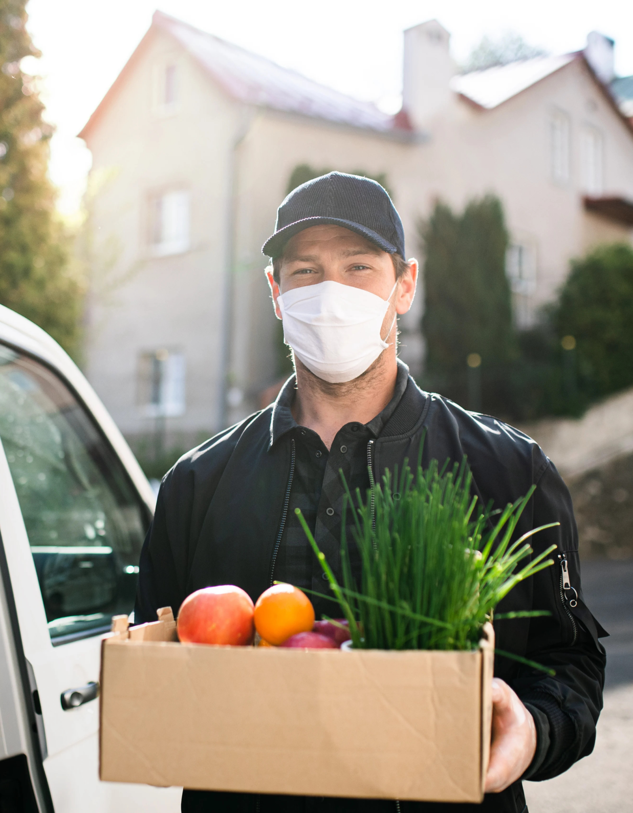 delivery-man-courier-with-face-mask-delivering-gro-MF6QAWP 1-1