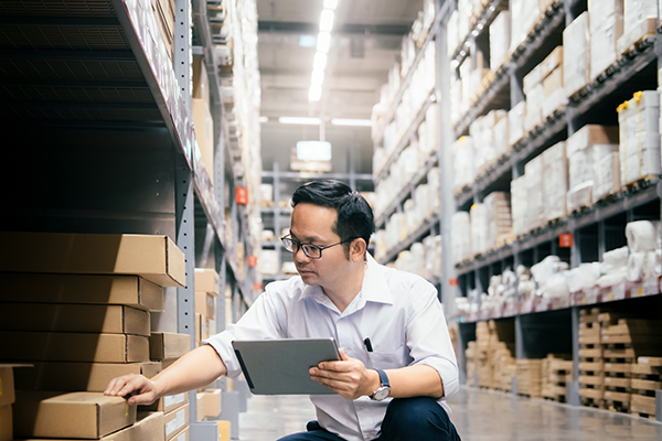 man-warehouse-worker-checking-goods-at-warehouse-3LZCGS5